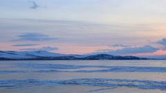 Sunset in the icy Lake Baikal, Irkutsk region, Russia. Full HD Stock Footage