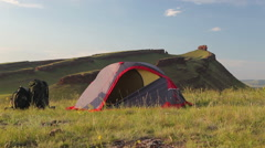 Tourist tent on meadow at the mountain in summer. Stock Footage