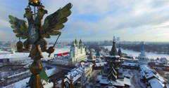2 headed eagle at the top of colorful roof of edifice of Izmaylovo Kremlin. - stock footage