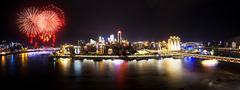 Cityscape and skyline of downtown near water of chongqing at night Stock Photos