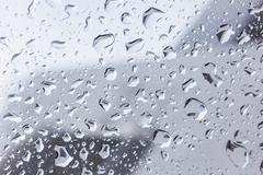 Drops of rain on glass , rain drops on clear window Kuvituskuvat