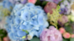 Arrangement of different flowers of different colors, standing on tables for a Stock Footage