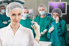 Anesthetist with syringe and surgery teem - stock photo