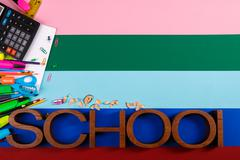 School or office stationery on colorful background. Back to School. Frame, co Stock Photos