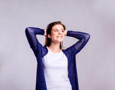 Girl in t-shirt and cardigan, young woman, studio shot Stock Photos