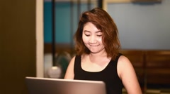 Sexy thai woman in black dress working on laptop Stock Footage