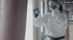 Slow motion Taekwondo Girl Trains With Punching Bag In The Gym Stock Footage