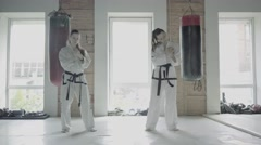 Two Taekwon-do Girls Warm Up Before Exercise Stock Footage