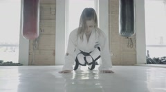 Taekwon-do Girl Doing Push-Up Exercise, Training In Gym, Look Stock Footage