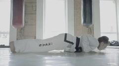 Taekwondo Girl Training Push Ups On Palms Stock Footage