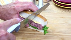 Cutting a roast beef sandwich Stock Footage