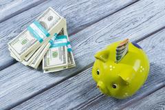 Folded dollars in money box. - stock photo