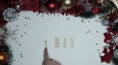 4k Christmas Composition on a White Background with Xmas wooden Letters Stock Footage