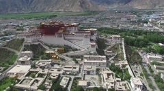 DOLLY AERIAL SHOT OF THE POTALA PALACE AND SURROUNDING COURTYARD IN TIBET Stock Footage
