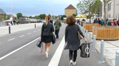 Women finished shopping and are now walking on the bridge with shopping bags Stock Footage