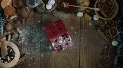 4k Christmas Composition on a Wooden Background with a House and Dropping Flour Stock Footage