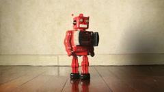 Retro robot on wooden floor Stock Footage