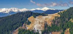 Landscape, spring snow-capped mountain range Stock Photos