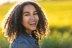 Mixed Race African American Girl Teenager With Perfect Teeth Stock Photos