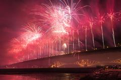 Group of people watching fireworks over Forth road bridge, Edinburgh, Scotland Stock Photos