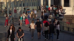 Unidentified рeople stroll on Patriarshy bridge, slow motion Stock Footage