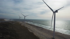 Success: renewable energy, wind mills at the Danish seashore  Stock Footage