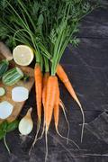 Closeup of fresh locally grown eco organic chopped vegetables on a cutting bo Stock Photos