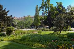 Zagreb park with trees and flowers and three people on segway Stock Photos