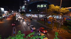 Bangkok evening streets traffic near MBK and Tokyu shopping Centres Stock Footage