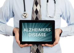 Doctor holding tablet - Alzheimers disease Stock Photos