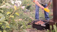 Chicken meat pieces being fried on a charcoal grill, outdoor Stock Footage