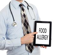Doctor holding tablet - Food allergy - stock photo
