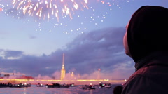 Man Watching Fireworks Beautifully Dissolvied In Magnifisent Night Sky Stock Footage