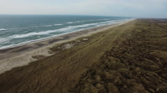 Environmental freedom: The Danish coastline with its sandy beach and green hills Stock Footage