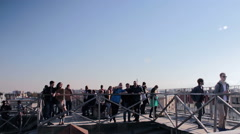 People On The Top Of The  Roof To Enjoy Breathtaking Cityscape Stock Footage