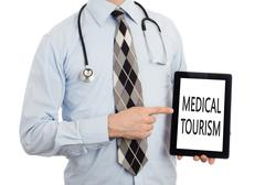 Doctor holding tablet - Medical tourism Stock Photos