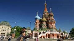 Saint Basil's Cathedral, tourists scurry around square, time lapse shot Stock Footage