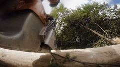 Cutting through wood with chainsaw. Slow motion. Closeup Stock Footage