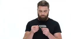 Man picking credit cards Stock Footage