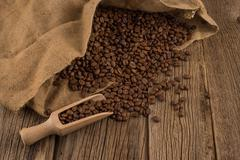 Flavor of coffee and wooden background Stock Photos