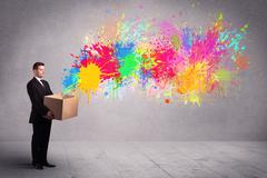 Colour splatter from box Stock Photos