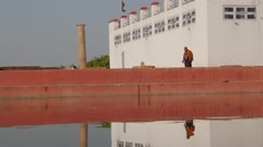 Monk walking in front of Maya Devi Temple,Lumbini,Nepal Stock Footage