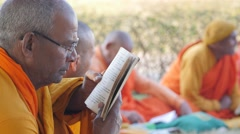 Buddhist monk reading book,Lumbini,Nepal Stock Footage