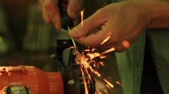 Sharpening side screwdriver on electrical grinding wheel Stock Footage
