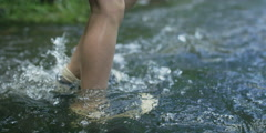 Slow motion of boy's feet wading river rapids, RED 4K Stock Footage