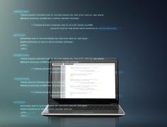 Laptop computer with coding on screen Stock Photos