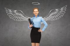 Happy businesswoman with angel wings and nimbus Stock Photos