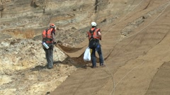 Landscapers Laying Coconut Coir Matting On Eroded Cliff Face Stock Footage