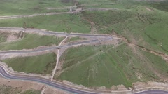 AERIAL FOLLOW SHOT OF TRUCK DRIVING ON INSANE WINDY MOUNTAIN ROAD Stock Footage