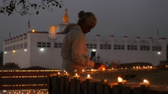 Pilgrim lighting candles,Lumbini,Nepal Stock Footage